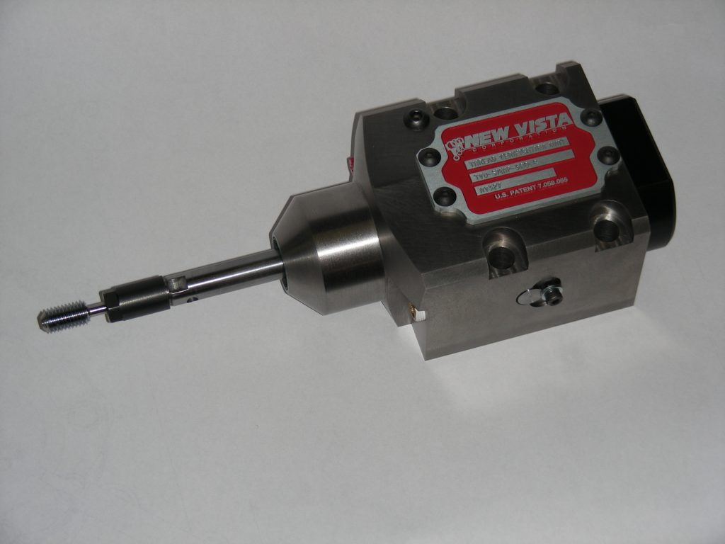 TVU-SMNP-500-C used in a CNC turning center.  This sealed Thread-Verifying Unit mounts on the machine tool's turret.  Air sensing is employed in this TVU so that no electrics need to be run to the turret.