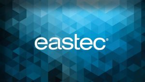 A triangular blue pattern with eastec's logo centralized.
